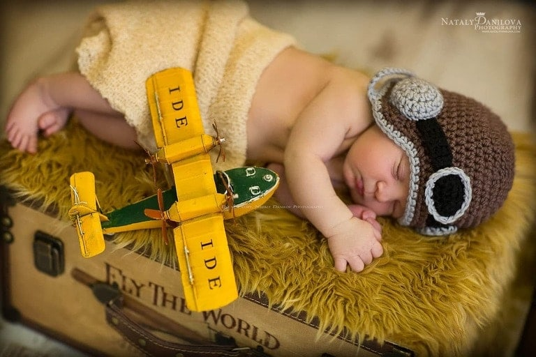 Baby pilot with a toy aircraft